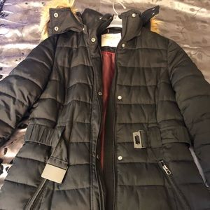 A women's Tommy Hilfiger coat and Addias dress.